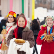 Women with pancake during Shrovetide — Stock Photo #11499773