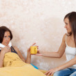 Woman gives cup to unwell girl — Stock Photo