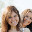 Stock Photo: Two mid adult happy women