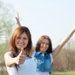 Happy women with thumb up — Stock Photo