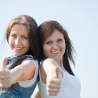 Royalty-Free Stock Photo: Happy women with thumb up