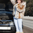 Woman with her broken car — Stock Photo #11499835