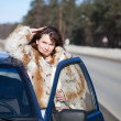 Woman with her car in winter — Stock Photo