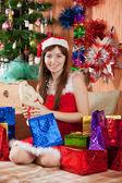 Girl with christmas presents — Stock Photo