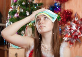 Woman in christmas hat having hangover — Stock Photo