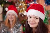 Girls in Santa hats — Stock Photo