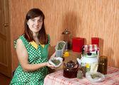 Woman brews herbs — Stock Photo