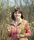 Woman in spring pussywillow plant — Stock Photo