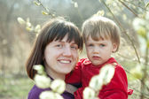 Mother with girl in spring — Stock Photo