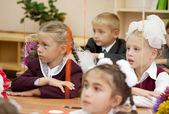 Schoolchildren in their first lesson — Stock Photo