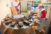 Baker is making Karlovarske oplatky (Czech national waffles) — Stock Photo