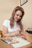 Manicurist working with female nails — Stock Photo