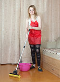Woman washes the floor with mop — Stock Photo