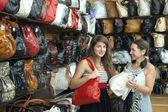 Women chooses leather bag — Stock Photo