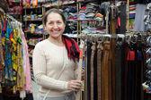Mature woman chooses strap — Stock Photo