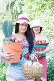 Women with vegetables in garden — Stock Photo