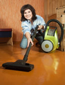 Girl cleans with vacuum cleaner — Stock Photo