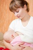 Baby breast feeding in home — Stock Photo
