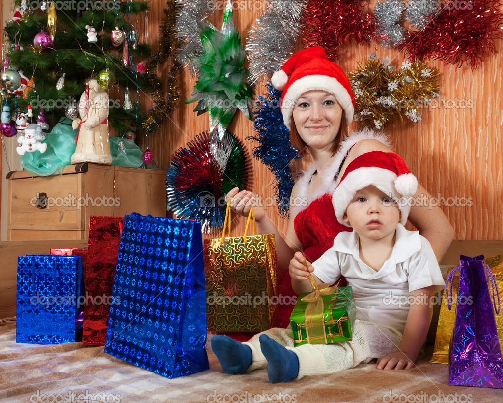 Happy family celebrating Christmas in living room — Stock fotografie #11499359
