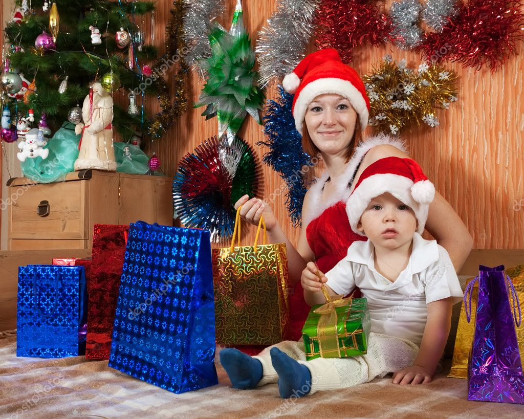 Happy family celebrating Christmas in living room — Stok fotoğraf #11499359