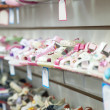 Counter with baby shoes — Stockfoto #11500059