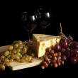 Grapes and cheese with glasses - Stock Photo