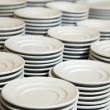 Many plates stacked together — Stock Photo