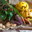 Halloween pumpkin and vegetables — Stock Photo