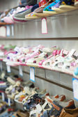 Counter with baby shoes — Stock Photo