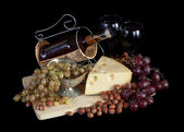 Wine with grapes and cheese — Stock Photo