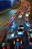 Traffic on night road — Stock Photo