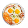 Fried eggs with bacon - Stock Photo