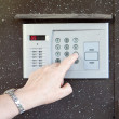 Close-up of uses intercom — Foto de Stock