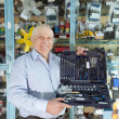 Royalty-Free Stock Photo: Man holds  automotive  correction tool set