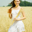 Girl  with beer and wheat ear — Stock Photo