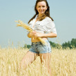 Girl with wheat ear — Stock Photo