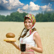 Girl with beer and bread — Stock Photo #12491625