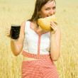 Stock Photo: Girl with quass and bread