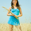 Girl with wheat ears — Stock Photo #12491644