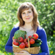 Happy girl with vegetables harvest — Stockfoto
