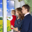 Family looking out the window — Stock Photo