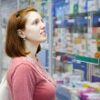Stock Photo: Womin pharmacy drugstore