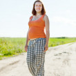 Pregnancy woman in  summer field - Stockfoto