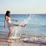 Happy woman at sea coast — Stock Photo #12495650