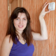 Woman with switch in home — Stock Photo #12495699