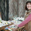 Foto de Stock  : Female gardener buys seeds