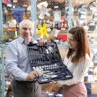 Mature man and woman holds  automotive   tool set - Foto Stock