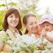Happy women and kid at summer garden — Stock Photo