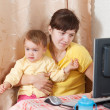 Woman with crying baby working  with computer - Stock Photo