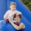 Happy mother with  toddler on slide — Stock Photo
